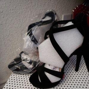 Shoes - Black heels.